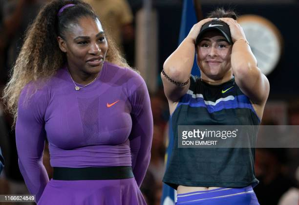 Bianca Andreescu of Canada and Serena Williams of the US react during the awards ceremony after their women's singles finals match at the 2019 US...