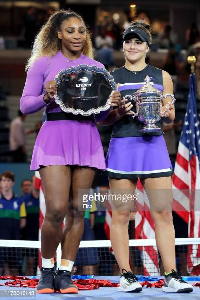 Bianca Andreescu of Canada celebrates with the championship trophy alongside runner up Serena Williams of the United States during the trophy...