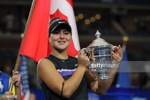 Bianca Andreescu of Canada celebrates with the championship trophy during the trophy presentation ceremony after winning the Women's Singles final...