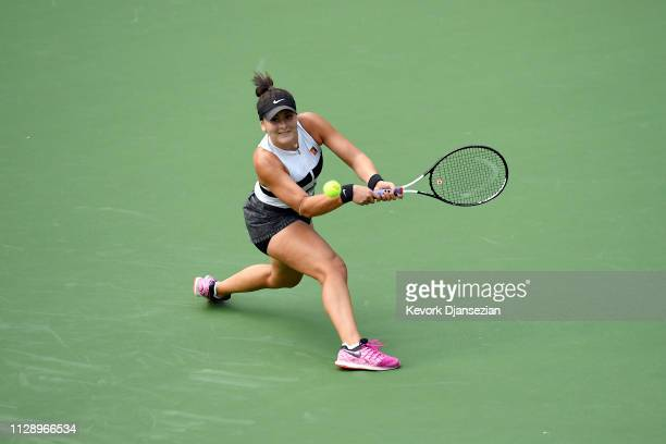 Bianca Andreescu of Canada hits a backhand against IrinaCamelia Begu of Romania during their ladies singles first round match on day three of the BNP...