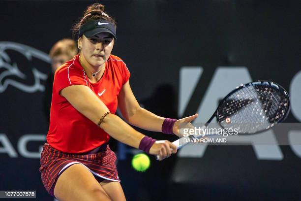 Bianca Andreescu of Canada hits a return against Venus Williams of the US during their women's singles quarterfinal match at the ASB Classic tennis...