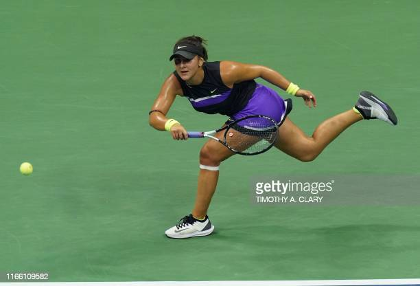 TOPSHOT Bianca Andreescu of Canada hits a return to Belinda Bencic of Switzerland during their semifinals women's Singles match at the 2019 US Open...