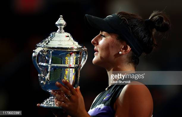 Bianca Andreescu of Canada holds the championship trophy during the trophy presentation ceremony after winning the Women's Singles final against...