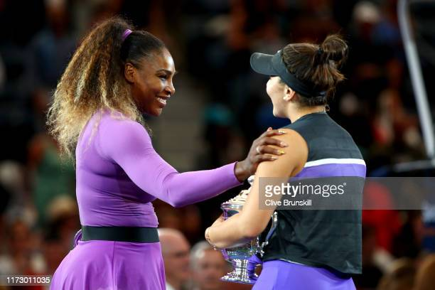 Bianca Andreescu of Canada is congratulated on her win by Serena Williams of the United States during the trophy presentation ceremony after the...