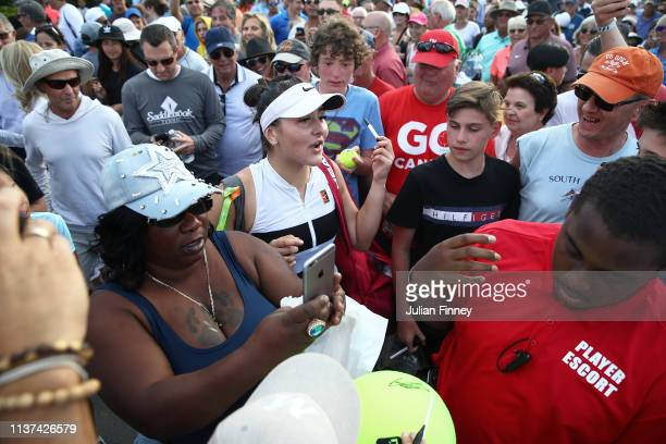 Bianca Andreescu of Canada is mobbed by fans after her three set win over IrinaCamelia Begu of Romania during day four of the Miami Open tennis on...