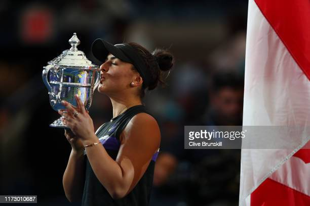 Bianca Andreescu of Canada kisses the championship trophy during the trophy presentation ceremony after winning the Women's Singles final against...