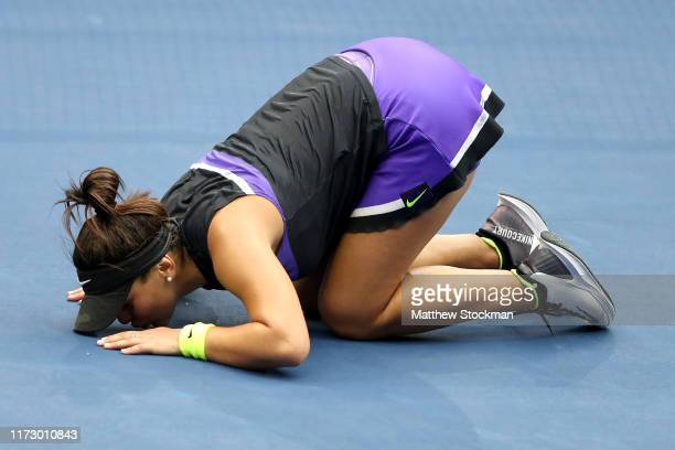 Bianca Andreescu of Canada kisses the court in celebration of winning the Women's Singles final match against Serena Williams of the United States on...