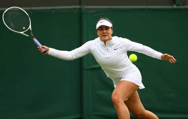 Bianca Andreescu of Canada plays a forehand in her Ladies' Singles First Round match against Alize Cornet of France during Day Three of The...