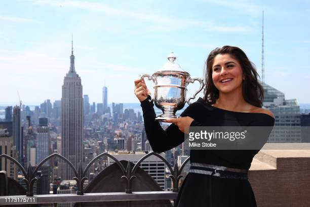 Bianca Andreescu of Canada poses with her trophy at the Top of the Rock in Rockefeller Center on September 8 2019 in New York City