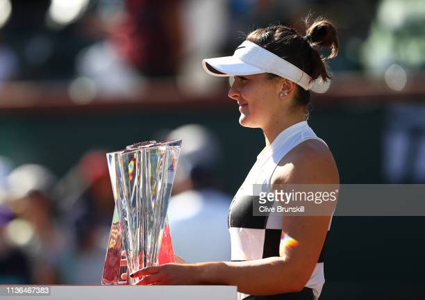 Bianca Andreescu of Canada poses with her womens singles trophy after her three set victory against Angelique Kerber of Germany in the womens final...