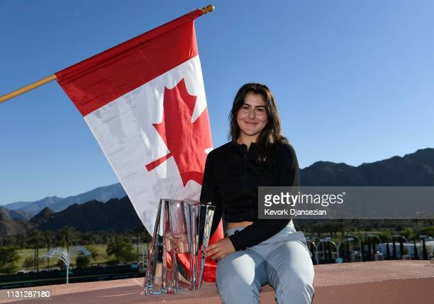 Bianca Andreescu of Canada poses with the championship trophy after her three set victory against Angelique Kerber of Germany in the women's final on...