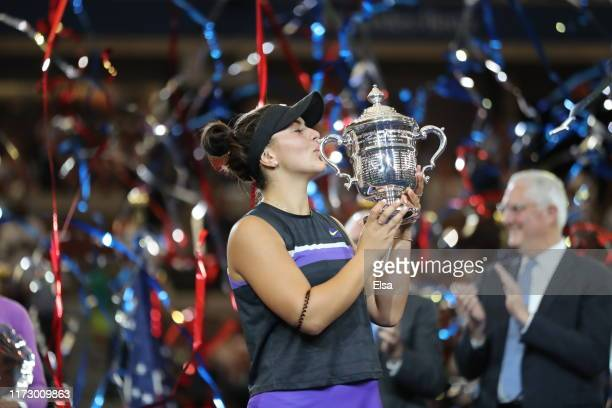 Bianca Andreescu of Canada poses with the championship trophy after winning the Women's Singles final match against Serena Williams of the United...