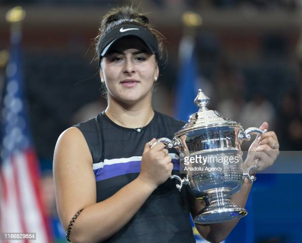 Bianca Andreescu of Canada poses with the trophy after her US Open Championships women's singles final match against Serena Williams of USA at Billie...