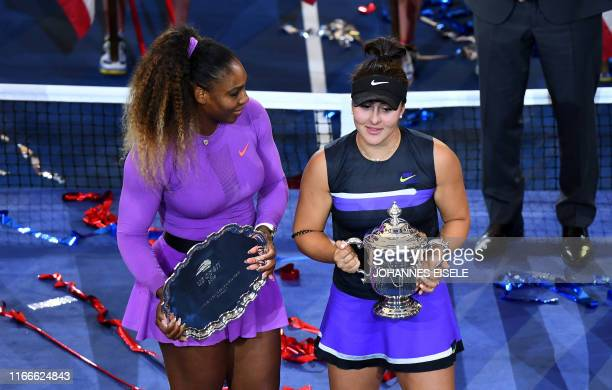 TOPSHOT Bianca Andreescu of Canada poses with the trophy after she won against Serena Williams of the US after the Women's Singles Finals match at...