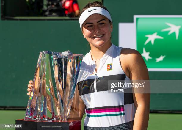 Bianca Andreescu of Canada poses with the winner's trophy, after beating Angelique Kerber of Germany in the final of the women's singles of the BNP...