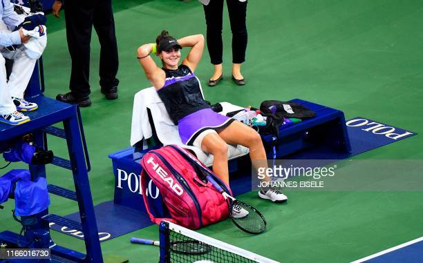 TOPSHOT Bianca Andreescu of Canada reacts after winning against Elise Mertens of Belgium during their Women's Singles Quarterfinals match at the 2019...