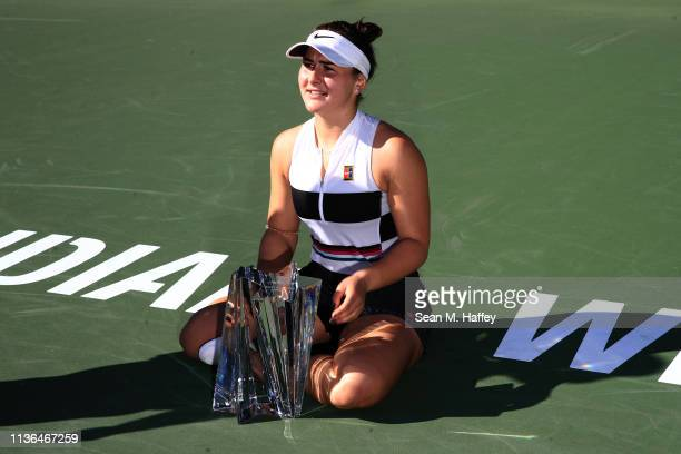 Bianca Andreescu of Canada reacts with the trophy after defeating Angelique Kerber of Germany after their women's singles final match at the BNP...