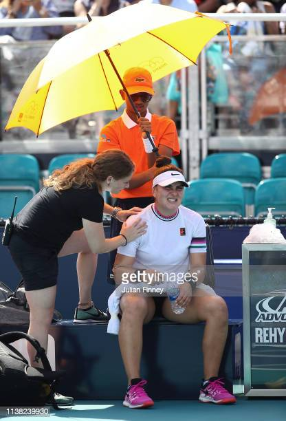 Bianca Andreescu of Canada receives treatment in her match against Anett Kontaveit of Estonia during the Miami Open Tennis on March 25 2019 in Miami...