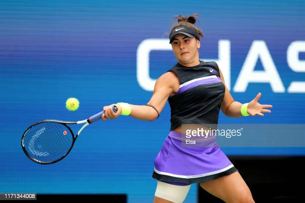 Bianca Andreescu of Canada returns a shot during her Women's Singles third round match against Caroline Wozniacki of Denmark on day six of the 2019...