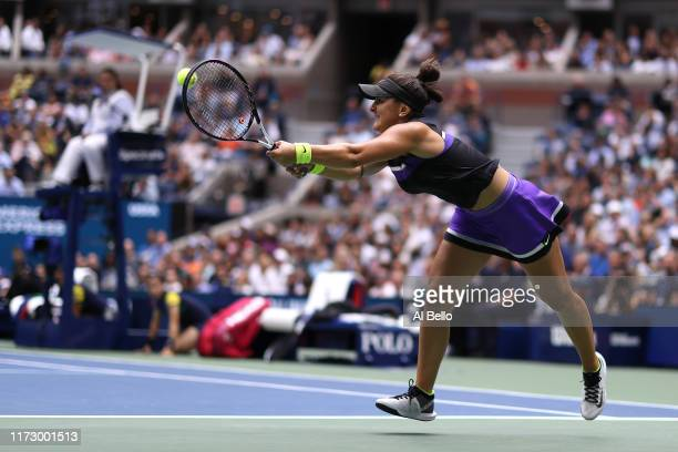 Bianca Andreescu of Canada returns a shot during her Women's Singles final match against Serena Williams of the United States on day thirteen of the...