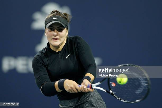 Bianca Andreescu of Canada returns a shot to Angelique Kerber of Germany during Day 6 of the Miami Open Presented by Itau at Hard Rock Stadium on...
