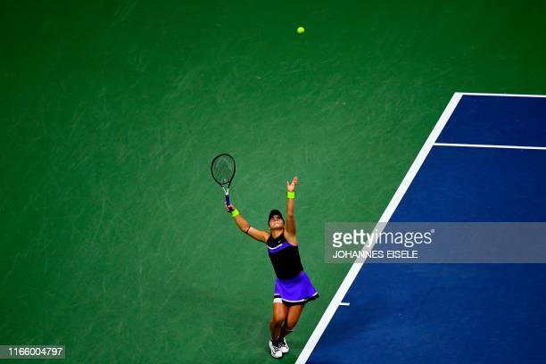 Bianca Andreescu of Canada serves against Elise Mertens of Belgium during their Women's Singles Quarterfinals match at the 2019 US Open at the USTA...