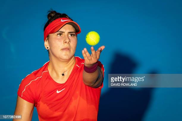 Bianca Andreescu of Canada serves in her women's singles semifinal match against Hsieh Suwei of Taiwan during the ASB Classic tennis tournament in...