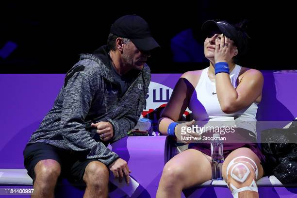 Bianca Andreescu of Canada speaks to her coach Sylvain Bruneau after sustaining an injury to her left leg during a break in her Women's Singles match...