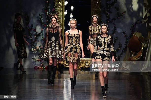 Bianca Balti and Natasha Poly walk the runway at the Dolce & Gabbana Autumn/Winter 2012/2013 fashion show as part of Milan Womenswear Fashion Week on...
