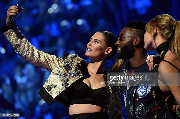 Bianca Balti Tinie Tempah and Hailey Baldwin present the award for Best Video on stage during the MTV EMA's 2015 at the Mediolanum Forum on October...