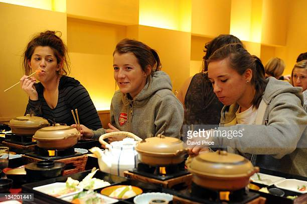 Bianca Bragg Angharad James and Jordan Nobbs of Arsenal Ladies FC players eat in a restaurant while visiting Kyoto during their tour to Japan on...