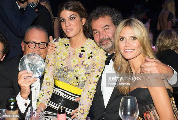 Bianca Brandolini d'Adda and Heidi Klum attend the amfAR Milano 2014 Gala Dinner and Auction as part of Milan Fashion Week Womenswear Spring/Summer...