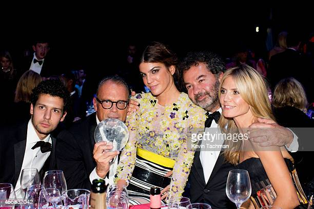 Bianca Brandolini d'Adda and Heidi Klum attend the amfAR Milano 2014 Gala Dinner and Auction as part of Milan Fashion Week Womenswear Spring/Summer...