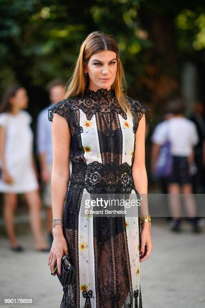 Bianca Brandolini wears a black lace mesh dress outside Giambattista Valli during Paris Fashion Week Haute Couture Fall Winter 2018/2019 on July 2...