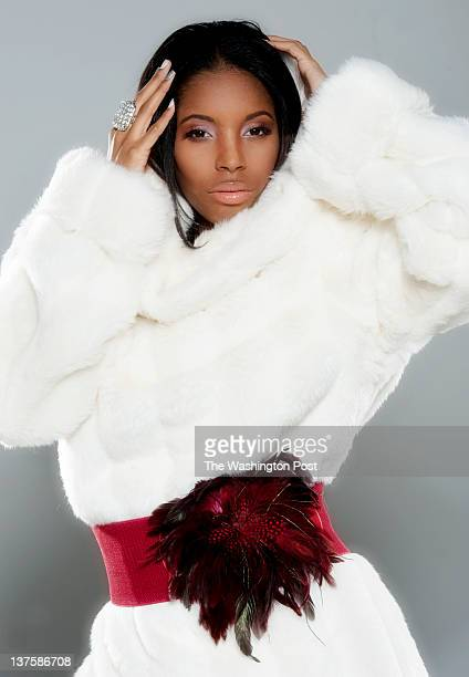 Bianca Branic wear a white fur by Afua Sam for a red themed fashion shoot in Rockville Maryland on January 08 2012 Fashion consultant Glynn Jackson...