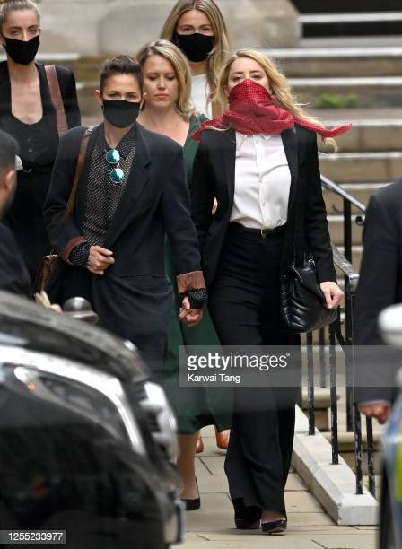 Bianca Butti and Amber Heard depart after attending the libel case between Johnny Depp and The Sun Newspaper at the Royal Courts of Justice at Royal...