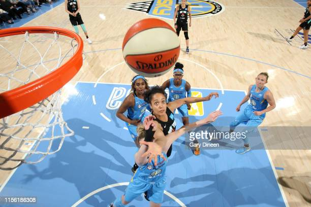 Bianca CuevasMoore of the New York Liberty reaches for control of the ball during the game against the Chicago Sky on July 12 2019 at the Wintrust...