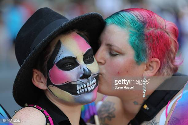 TORONTO ON JULY 3 Bianca Daigneault gets a kiss from Candice Persich during the the 2016 Toronto Pride parade along Yonge Street in Toronto July 3...