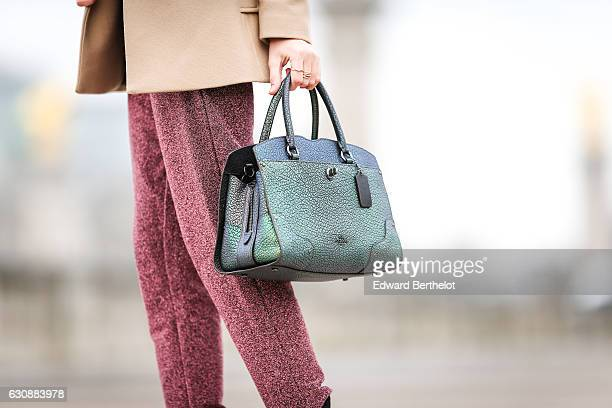 Bianca Derhy, fashion and life style influencer from the blog Bibi Goes Chic, is wearing a Maje white top, a Reiss beige jacket, NA-KD purple pants,...
