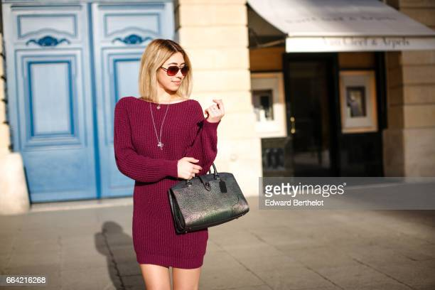 Bianca Derhy fashion blogger Bibi Goes Chic wears a Misspap purple sweater Daniel Footwear shoes with multicolor prints and a Coach green bag at...