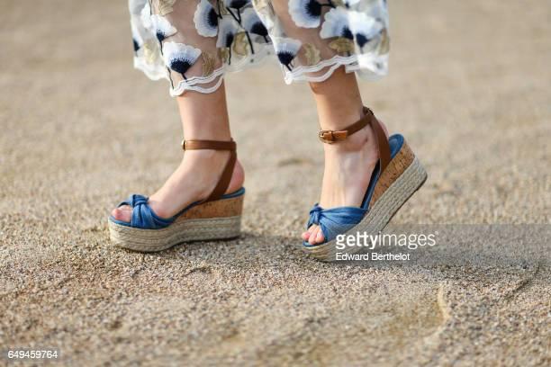 Bianca Derhy fashion blogger from Bibi Goes Chic wears an Asilio flower print dress a Coach green bag and Michael Kors shoes during Paris Fashion...