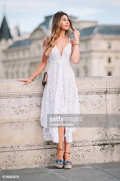 Bianca Derhy is wearing a For Love Lemons white dress Michael Kors shoes a golden necklace and a Valentino nude bag on October 21 2016 in Paris France