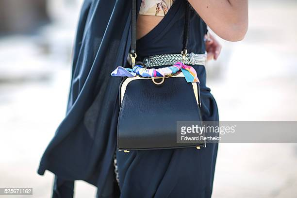 Bianca Derhy is wearing a Lacoste blue dress Bash shorts Tory Burch shoes and a Zara belt during a street style session on April 28 2016 in Paris...