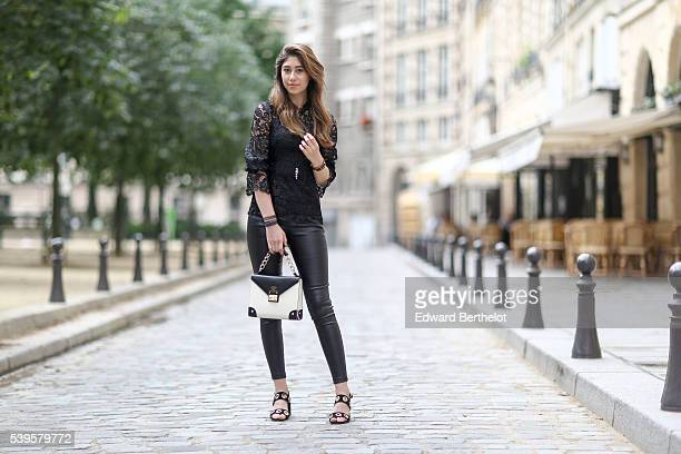 Bianca Derhy is wearing a Mossman Clothing black top Mossman Clothing black pants Topshop black shoes and a Charles Heritier black and white bag...