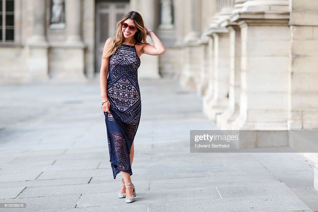 Bianca Derhy (fashion and lifestyle blogger - Bibi Goes Chic), wears a BCBG blue dress, and Kurt Geiger silver colored shoes at the Louvre on September 24, 2016 in Paris, France.