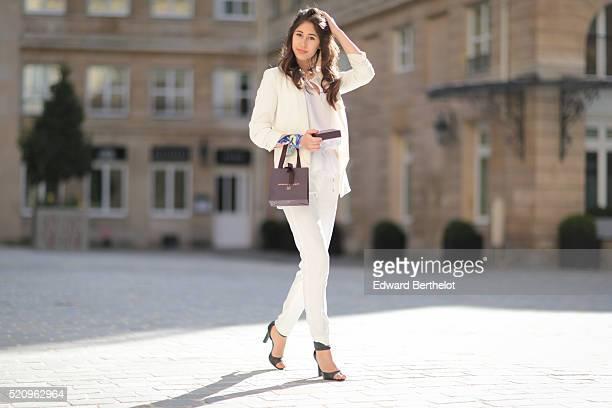 Bianca Dhery is wearing a Michael Kors white top a Zara white blazer jacket The Kooples white pants Charles Keith black heels a Monica Vinader...