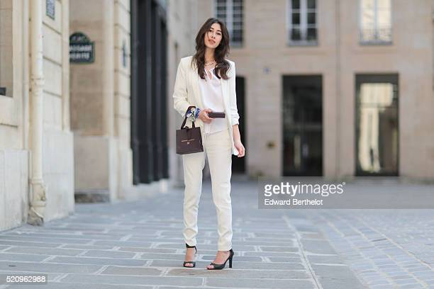 Bianca Dhery is wearing a Michael Kors white top a Zara white blazer jacket The Kooples white pants Charles Keith black heels a Monica Vinader...