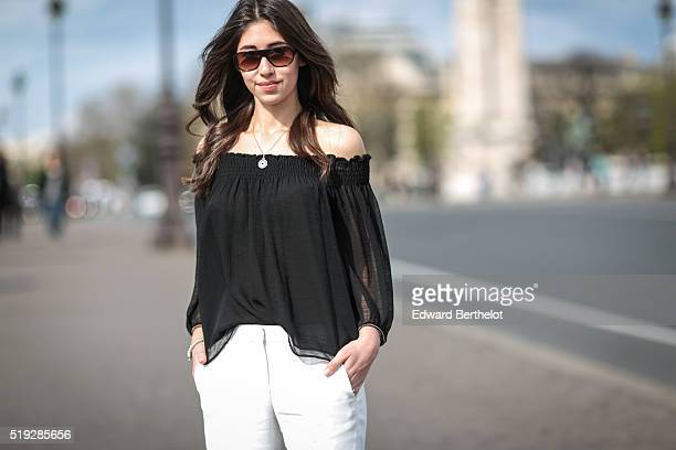 Bianca Dhery is wearing The Kooples white pants a Zara black top and sunglasses during a street style session in the 7th quarter of Paris on April 5...