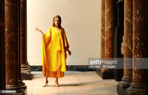 Bianca Gaurilas wears a Golden Spider silk cape which is made from the golden silk of 12million spiders as it goes on display at the VA Museum London
