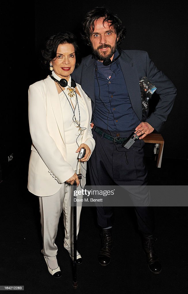 Bianca Jagger (L) and Andreas Kronthaler attend the dinner to celebrate The David Bowie Is exhibition in partnership with Gucci and Sennheiser at the Victoria and Albert Museum on March 19, 2013 in London, England.